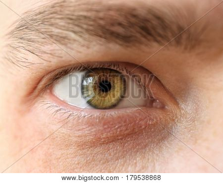Young man with contact lenses, closeup