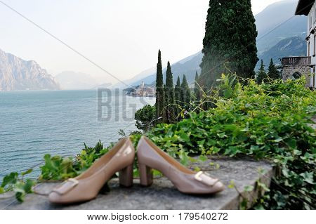 Garda lake Italy and wedding bride shoes