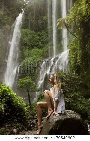 Beautiful woman and waterfall.