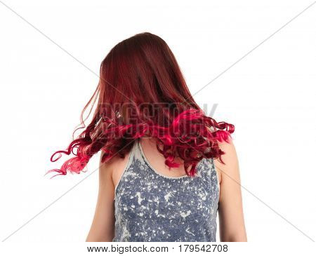 Beautiful young woman with dyed hair on white background