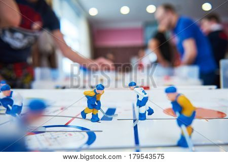 table hockey game with player on background