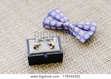 Groom cufflinks and bow tie - wedding accessory details