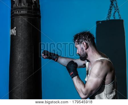 Sports Man Boxing Bag In The Gym