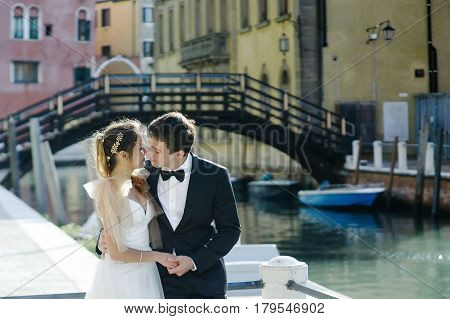 Tender young bride and groom in wedding day in Venice Italy