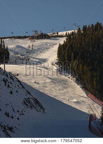 Mass downhill skiing on Todorka mountain Bansko ski resort Bulgaria