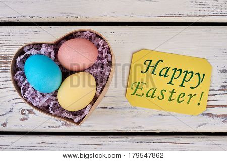 Easter egg box, greeting card. Painted eggs in shredded paper. How to make Easter gifts.