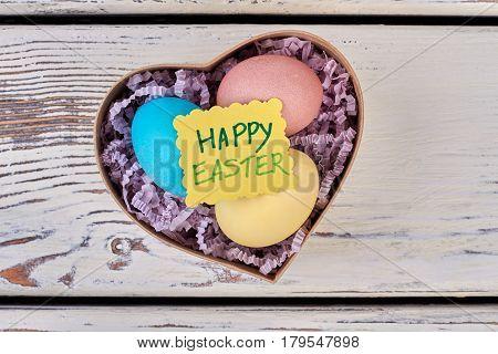 Greeting card, Easter egg box. Chicken eggs in shredded paper.