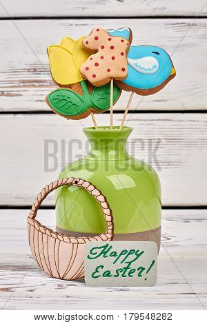 Vase with biscuits and card. Easter plywood craft and food.