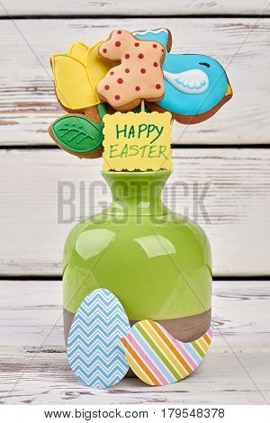 Easter biscuits and paper crafts. Vase with greeting card.