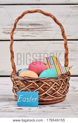Basket and Easter card. Colorful paper bird cutout.