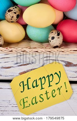 Happy Easter card on wood. Painted chicken eggs. Famous religious holiday.