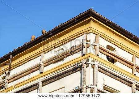 Facade of an old italian masonry building with metal tie-rod and anchor plate.