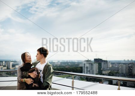 Couple Walking With Dog Outdoors