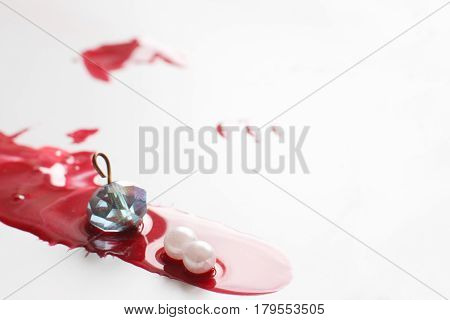 Murder, robbery jewelry, theft. Drops of red blood isolated on white background with free space, close up view. Creative modern art, abstractionism.