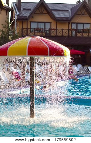 the summer pool in hot sunny day. a concept of summer holiday in aquapark. concept of recreation.