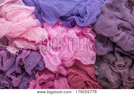 Multicolored background of violet purple pink and crimson colors of gauze fabric
