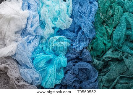 Multicolored background of blue blue green blue-salted turquoise colors of gauze fabric.