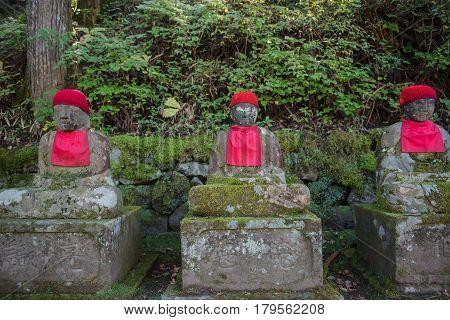 NIKKO, JAPAN - OCTOBER 15 ,2016 : Nikko, Japan Jizo statues in Kanmangafuchi Abyss . many  stony sculptures of Buddha.