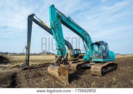 Two Excavators Stay After The Hard Work.