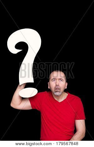 A man looking stupid holding a question mark in his hand