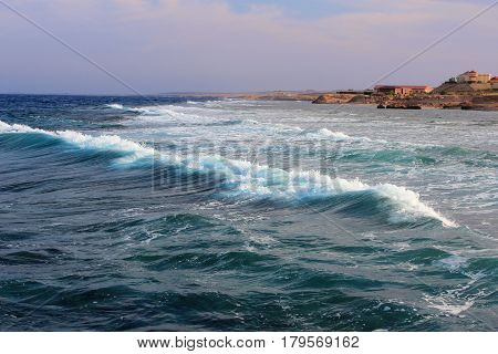 Powerful ocean wave approaching the shore. Egipt.