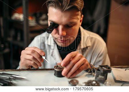 Clock maker repair old clockwork gear