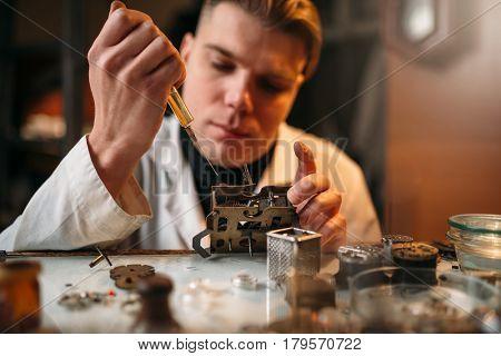 Watchmaker oil lubricates the mechanism of clock