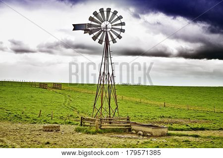 Close-up of a windmill and cloudy sky