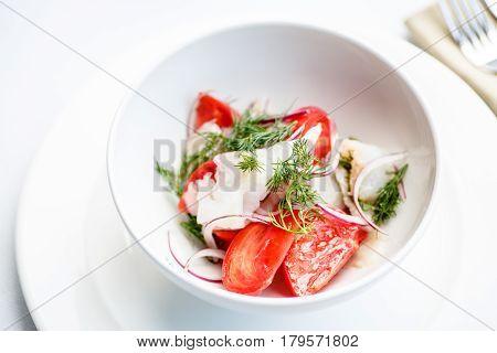 Salad Of Tomatoes Onions And Smoked Halibut.