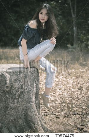 portrait of beautiful asian younger woman posting like fashion model outdoor