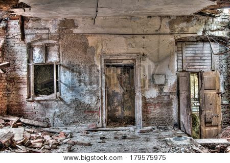 Door and window - interior of the old abandoned and crumbling building