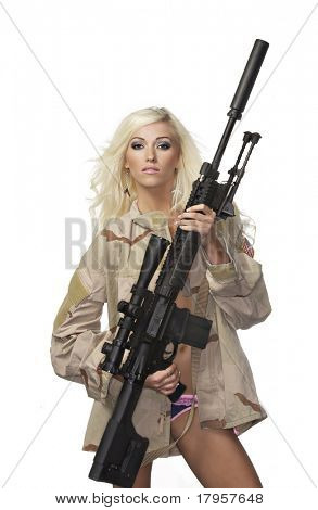 Beautiful armed blond woman wearing army camo flak jacket and lingerie holding massive heavy duty gun.