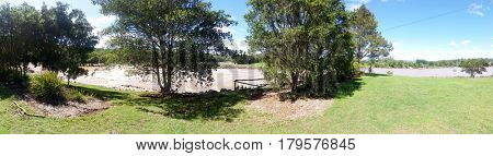 GOLD COAST, QUEENSLAND, AUSTRALIA - MARCH 31ST: Flood waters Panorama at the Coomera River Weir on 31st March at Oxenford