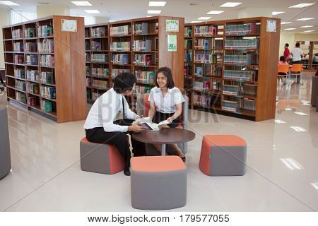 Bangkok, Thailand - November 17, 2015 :  King Mongkut's Institute of Technology Ladkrabang is a research and educational institution in Thailand. Students working in the university library.