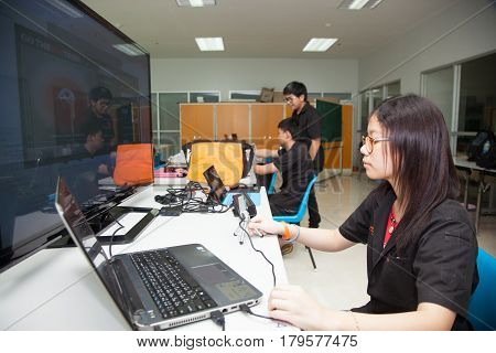 Bangkok, Thailand - November 17, 2015 :  King Mongkut's Institute of Technology Ladkrabang is a research and educational institution in Thailand. A class of high school students study electronics and robotics.