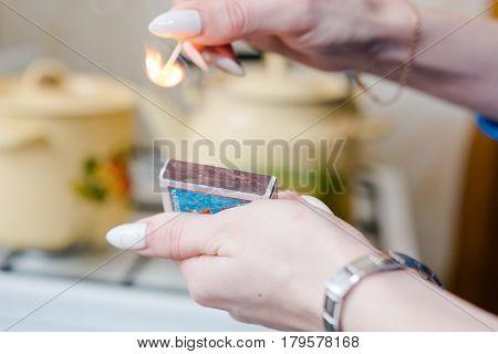 To Light A Match. The Woman Lights A Match,