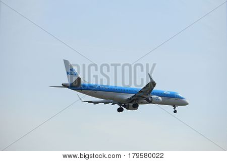 Amsterdam the Netherlands - March 31st 2017: PH-EZT KLM Cityhopper Embraer ERJ-190STD approaching Polderbaan runway at Schiphol Amsterdam Airport the Netherlands