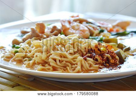 instant noodle dressing seafood gravy sauce and egg on plate