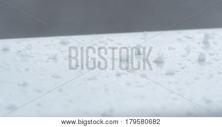 hailstones falling and bouncing on window slope, 4k photo