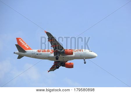 Amsterdam the Netherlands - March 31st 2017: G-EZBU easyJet Airbus A319-100 approaching Polderbaan runway at Schiphol Amsterdam Airport the Netherlands
