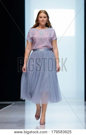 MOSCOW RUSSIA - MARCH 21 2017: Model walk runway for FABERLIC by VALENTIN YUDASHKIN catwalk at Autumn-Winter 2017-2018 Moscow Fashion Week. Plus-size fashion models.