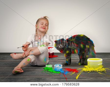 Happy child painted cat with colored inks. Girl and pet. Creativity and creative development in children