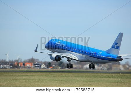Amsterdam the Netherlands - March 25th 2017: PH-EZE KLM Cityhopper Embraer ERJ-190 takeoff from Polderbaan runway.