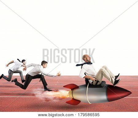 Businessman fly with rocket during a race with opponents