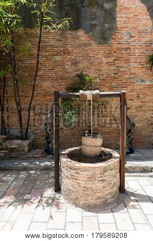 old rotten water well with Pulley and Bucket