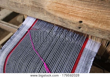 Old Weaving Loom And Thread Of Yarn. A Traditional Hand-weaving Loom Being Used To Make Cloth At Hom