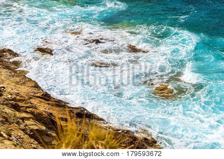 Waves Break On Rocky Shore. Bali, Crete