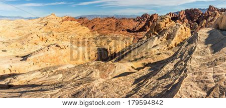 a panoramic landscape of the rugged red rocks in valley of fire state park Nevada