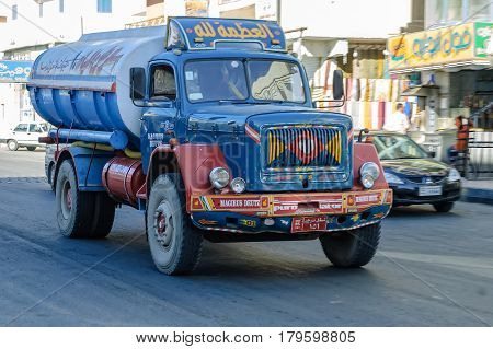 Hurghada, Egypt - November 7, 2006: Sewerage truck on street moving to clean up sewerage overflows, cleaning pipelines and potential pollution issues