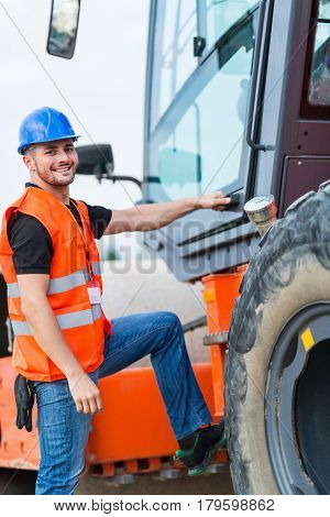 Portrait of manual Worker on Skid Steer Loader color image